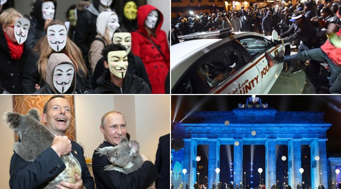 November 2014 in pictures: Comets, riots and marches…oh my!